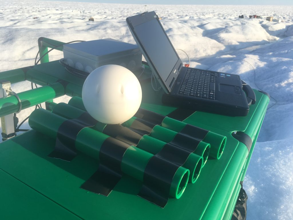 Cryoegg, pictured with the receiver box and laptop.