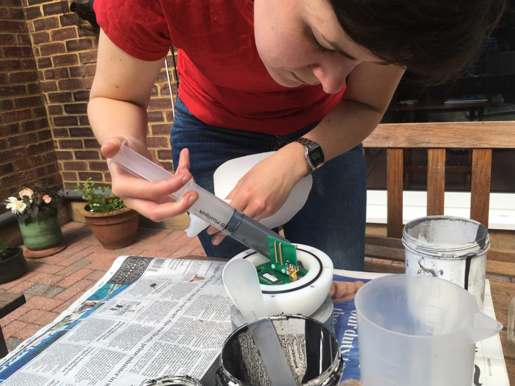 Liz fills Cryoegg with rubber potting compound